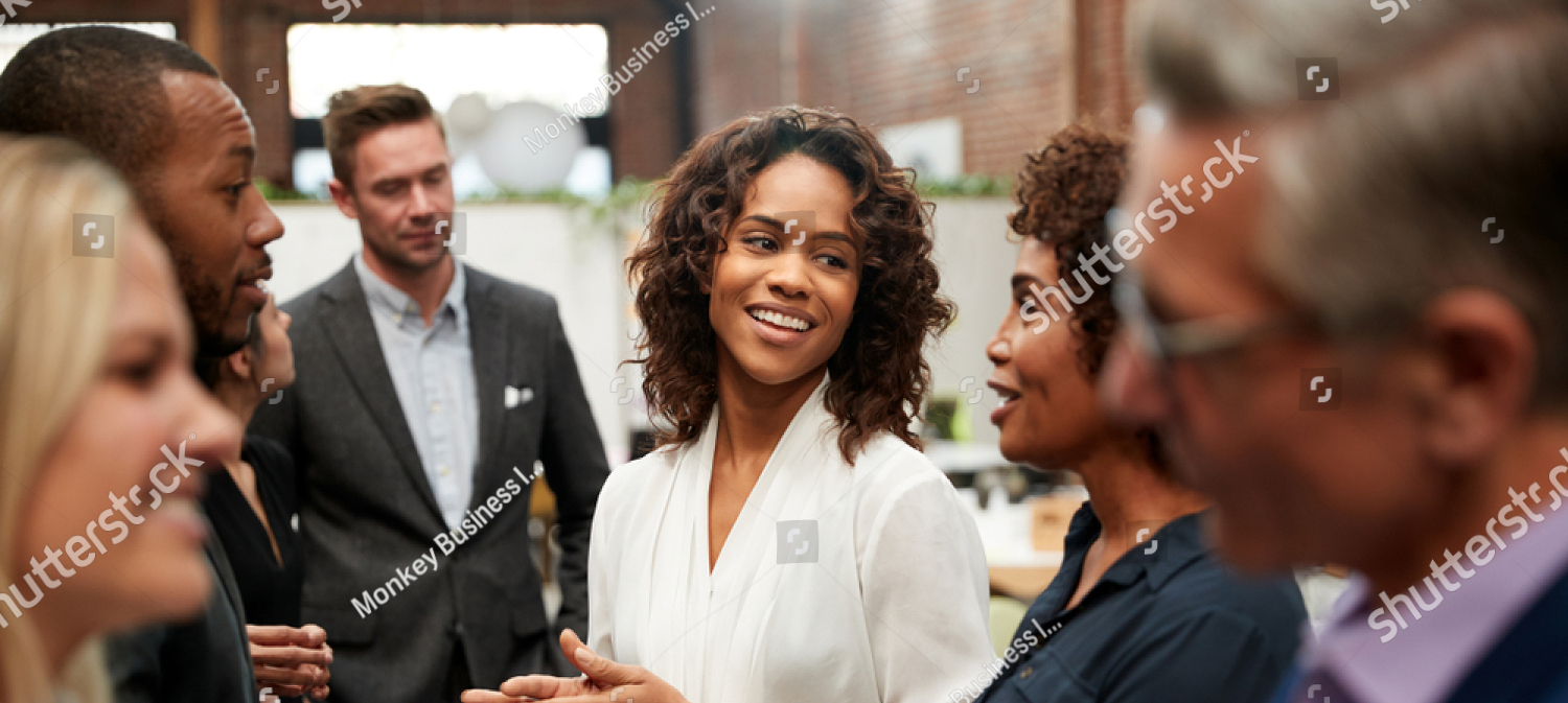 stock Photo Business Team Standing Having Informal Meeting In Modern Office 1348773422 Mobile